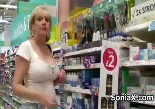 mature hottie shows sexy assets in public