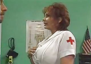 mature nurse drilled in hospital