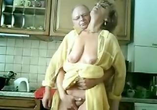 Se mum and dad having fun in the kitchen. Stolen