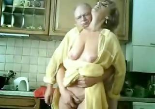 Mommy and daddy having fun in the kitchen. Stolen